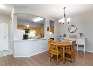 "Photo 4: 108 20239 MICHAUD Crescent in Langley: Langley City Condo for sale in ""CITY GRANDE"" : MLS®# R2494480"