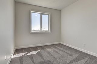 Photo 24: 132 Creekside Drive SW in Calgary: C-168 Semi Detached for sale : MLS®# A1098272