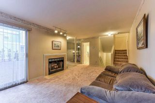 """Photo 4: 105 10091 156 Street in Surrey: Guildford Townhouse for sale in """"Guildford Park"""" (North Surrey)  : MLS®# R2321879"""