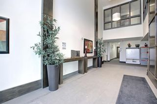 Photo 4: 2407 15 SUNSET Square: Cochrane Apartment for sale : MLS®# A1072593