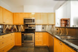 """Photo 7: 408 1990 E KENT AVENUE SOUTH in Vancouver: South Marine Condo for sale in """"HARBOUR HOUSE AT TUGBOAT LANDING"""" (Vancouver East)  : MLS®# R2539261"""