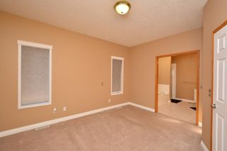 Photo 29: 303 GLENEAGLES View: Cochrane House for sale : MLS®# C4130061