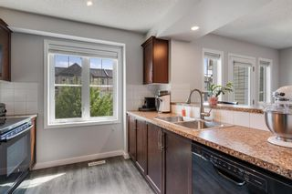Photo 4: 108 Windstone Park SW: Airdrie Row/Townhouse for sale : MLS®# A1127822