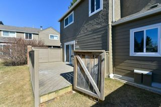 Photo 6: 1301 829 Coach Bluff Crescent in Calgary: Coach Hill Row/Townhouse for sale : MLS®# A1094909