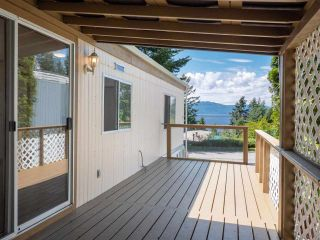 """Photo 16: 7 12248 SUNSHINE COAST Highway in Madeira Park: Pender Harbour Egmont Manufactured Home for sale in """"SEVEN ISLES"""" (Sunshine Coast)  : MLS®# R2604086"""