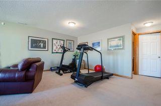 Photo 25: 97 STRATHEARN Gardens SW in Calgary: Strathcona Park House for sale : MLS®# C4121195