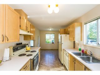 """Photo 6: 101 15439 100 Avenue in Surrey: Guildford Townhouse for sale in """"PLUM TREE LANE"""" (North Surrey)  : MLS®# R2095755"""