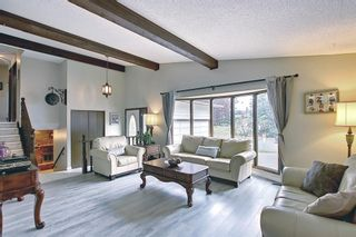 Photo 4: 335 Queensland Place SE in Calgary: Queensland Detached for sale : MLS®# A1137041