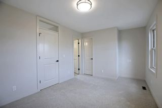 Photo 21: 218 29 Avenue NW in Calgary: Tuxedo Park Detached for sale : MLS®# A1150571