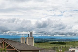 Photo 21: 9 140 Rockyledge View NW in Calgary: Rocky Ridge Row/Townhouse for sale : MLS®# A1118889