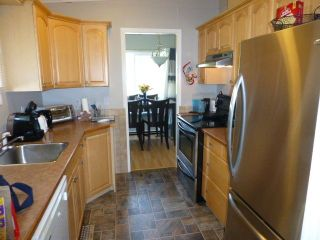 """Photo 4: 138 3665 244 Street in Langley: Otter District Manufactured Home for sale in """"LANGLEY GROVE ESTATES"""" : MLS®# R2306530"""