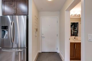 Photo 6: 309 8531 8A Avenue SW in Calgary: West Springs Apartment for sale : MLS®# A1121535