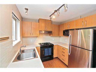 Photo 2: 107 300 KLAHANIE Drive in Port Moody: Port Moody Centre Condo for sale : MLS®# V1118205