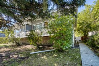 Photo 2: 726-728 Kingsmere Crescent SW in Calgary: Kingsland Duplex for sale : MLS®# A1145187