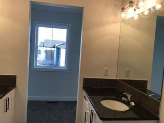 Photo 33: 11 Sundown Manor: Cochrane Semi Detached for sale : MLS®# A1071566