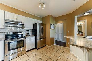 """Photo 4: 411 10188 155 Street in Surrey: Guildford Condo for sale in """"Summerset"""" (North Surrey)  : MLS®# R2297665"""