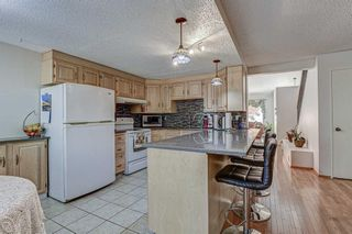 Photo 14: 7 Strandell Crescent SW in Calgary: Strathcona Park Detached for sale : MLS®# A1150531