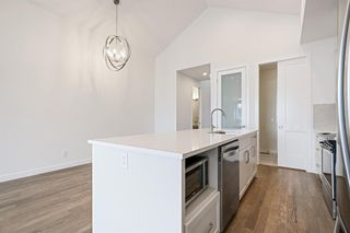 Photo 17: 12562 Crestmont Boulevard SW in Calgary: Crestmont Row/Townhouse for sale : MLS®# A1117892