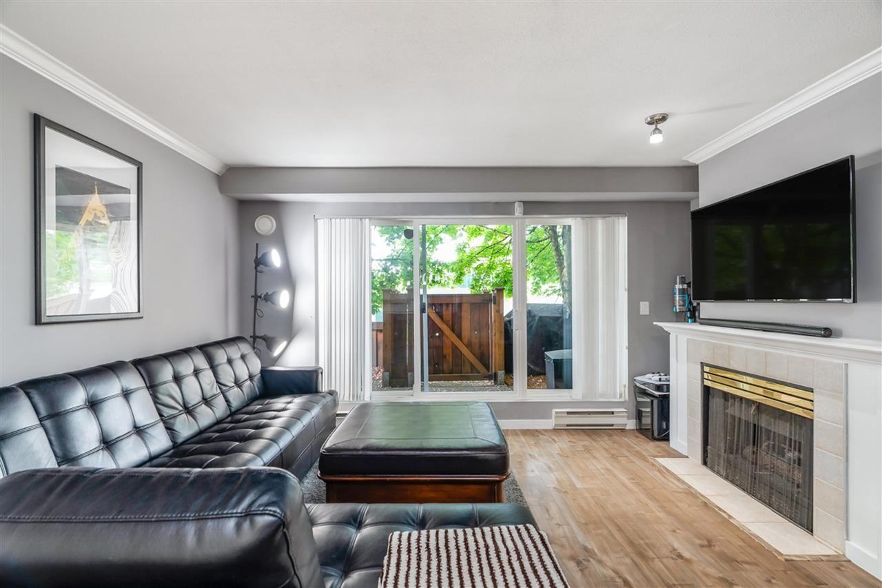 "Main Photo: 113 1570 PRAIRIE Avenue in Port Coquitlam: Glenwood PQ Condo for sale in ""VIOLAS ON PRAIRIE"" : MLS®# R2576813"