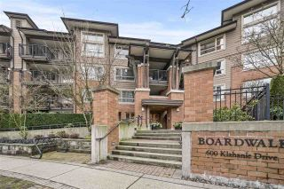 "Photo 1: 304 600 KLAHANIE Drive in Port Moody: Port Moody Centre Condo for sale in ""BOARDWALK"" : MLS®# R2541835"