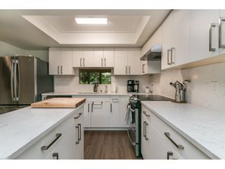 """Photo 3: 8204 FOREST GROVE Drive in Burnaby: Forest Hills BN Townhouse for sale in """"HENLEY ESTATES"""" (Burnaby North)  : MLS®# R2621555"""