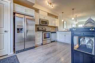 Photo 2: 100 Legacy Main Street SE in Calgary: Legacy Row/Townhouse for sale : MLS®# A1095155