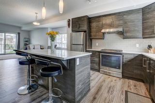 Photo 12: 135 NOLANCREST Common NW in Calgary: Nolan Hill Row/Townhouse for sale : MLS®# A1105271
