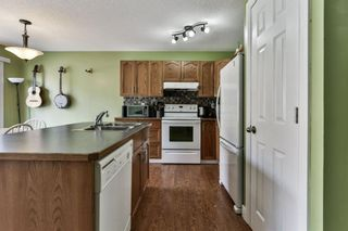 Photo 5: 93 Rocky Vista Circle NW in Calgary: Rocky Ridge Row/Townhouse for sale : MLS®# A1071802