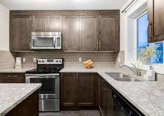 Photo 10: 102 2400 RAVENSWOOD View SE: Airdrie Row/Townhouse for sale : MLS®# A1092501