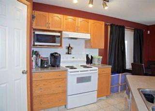 Photo 11: 48 CIMARRON MEADOWS Road: Okotoks House for sale : MLS®# C4174831