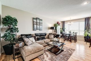 Photo 2: 105 Rainbow Falls Boulevard: Chestermere Semi Detached for sale : MLS®# A1144465