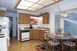 "Photo 3: 221 7156 121 Street in Surrey: West Newton Townhouse for sale in ""Glenwood Village"" : MLS®# R2215838"