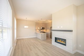 """Photo 3: 406 2120 GLADWIN Road in Abbotsford: Central Abbotsford Condo for sale in """"THE ONYX AT MAHOGANY"""" : MLS®# R2614339"""