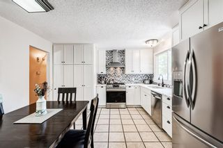 Photo 8: 459 Queen Charlotte Road SE in Calgary: Queensland Detached for sale : MLS®# A1122590