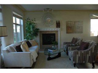 Photo 2: 3686 E GEORGIA ST in Vancouver: Renfrew VE House for sale (Vancouver East)  : MLS®# V1040327