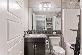 Photo 26: 161 Willow Green: Cochrane Duplex for sale : MLS®# A1020334