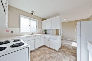 Photo 4: 539 HUNTERPLAIN Hill NW in Calgary: Huntington Hills Detached for sale : MLS®# A1024979