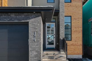 Photo 2: 154 69 Street SW in Calgary: Strathcona Park Residential for sale : MLS®# A1054727