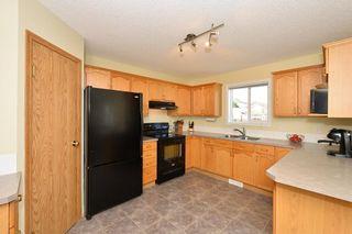 Photo 3: 41 BRIDLERIDGE Gardens SW in Calgary: Bridlewood House for sale : MLS®# C4135340