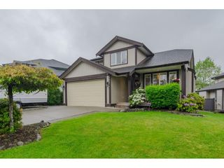 """Photo 1: 18276 69 Avenue in Surrey: Cloverdale BC House for sale in """"Cloverwoods"""" (Cloverdale)  : MLS®# R2369738"""