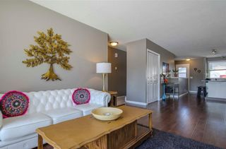 Photo 6: 75 SUMMERWOOD Road SE: Airdrie House for sale : MLS®# C4174518