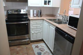 "Photo 8: 404 14377 103 Avenue in Surrey: Whalley Condo for sale in ""CLARIDGE COURT"" (North Surrey)  : MLS®# R2102251"