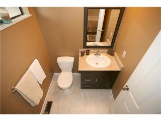 "Photo 7: 557 CARLSEN Place in Port Moody: North Shore Pt Moody Townhouse for sale in ""EAGLE POINT"" : MLS®# V835962"