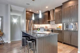 Photo 7: 2 4728 17 Avenue NW in Calgary: Montgomery Row/Townhouse for sale : MLS®# A1125415