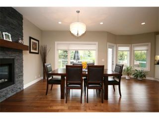 Photo 8: 156 GLENEAGLES Close: Cochrane House for sale : MLS®# C4018066
