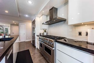 Photo 10: 9 Manor Road SW in Calgary: Meadowlark Park Detached for sale : MLS®# A1116064