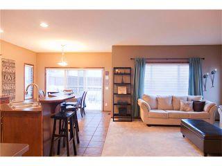 Photo 7: 79 CRANWELL Crescent SE in Calgary: Cranston House for sale : MLS®# C4044341