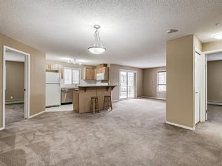 Photo 3: 3201 60 PANATELLA Street NW in Calgary: Panorama Hills Apartment for sale : MLS®# A1094380