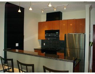 "Photo 1: 202 928 RICHARDS Street in Vancouver: Downtown VW Condo for sale in ""SAVOY"" (Vancouver West)  : MLS®# V654619"