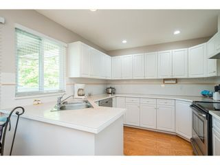 """Photo 10: 112 13888 70 Avenue in Surrey: East Newton Townhouse for sale in """"Chelsea Gardens"""" : MLS®# R2594142"""